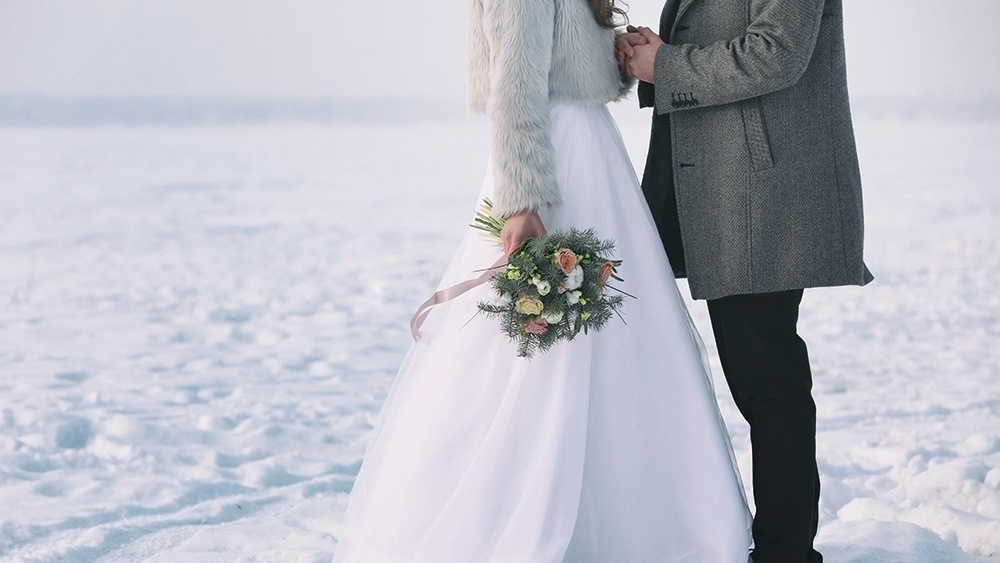 WEB - Winter Wedding Couple Snow Flowers.jpeg-621285-edited.jpg